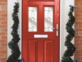 A red composite front door, providing the best value for money and security possible