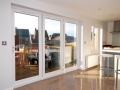 Open and airy Bi-Fold doors in white - An ideal way to give you a large amount of natural light whilst maintaining security