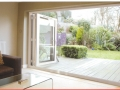 white bi-fold large opening doors with double glazing