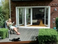 Patio white bi-fold doors fully glazed transform a room into a new area